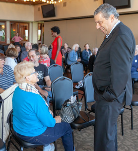 "John ""Bowzer"" Bauman of the band Sha Na Na and head of The Social Security Works Political Action Committee talks with Woodstock resident Mary Ann Rada Thursday, September 26, 2018 at Pinecrest Golf Club in Huntley. The event was held to endorse and show support for 14th congressional District Democratic Candidate Lauren Underwood.  KKoontz – For Shaw Media"