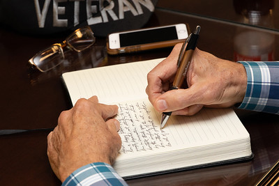 Dick Hattan a Vietnam veteran and author of Invisible Scars of War writes in his journal during a group writing class that he leads at the Veterans Family Services Center in McHenry Thursday, September 27, 2018. KKoontz – For Shaw Media