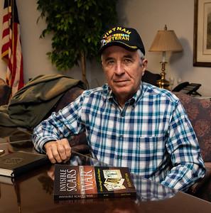 Dick Hattan a Vietnam veteran and author of Invisible Scars of War takes time to pose for a photo at the Veterans Family Services Center in McHenry Thursday, September 27, 2018. KKoontz – For Shaw Media
