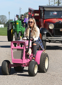 Candace H. Johnson-For Shaw Media Allison Sterbenz, 22, of Lake Zurich drives a 1963 International Cub Cadet in the Lake County Farm Heritage Parade during the Farm Heritage & Harvest Festival at the Lake County Fairgrounds in Grayslake. (9/22/18)