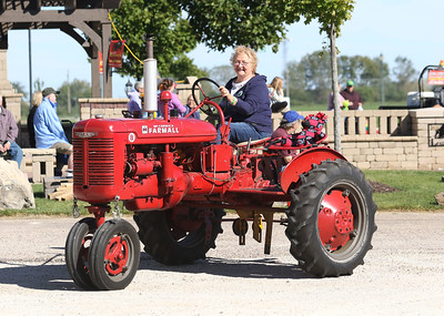 Candace H. Johnson-For Shaw Media Linda Werhane, of Grayslake drives a 1945 International B tractor in the Lake County Farm Heritage Parade during the Farm Heritage & Harvest Festival at the Lake County Fairgrounds in Grayslake. (9/22/18)