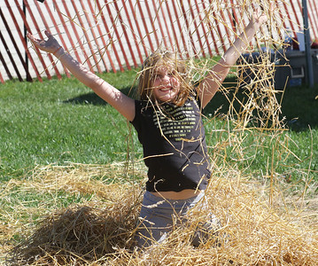 Candace H. Johnson-For Shaw Media Emma McMillon, 9, of Trevor, Wis., plays in a pile of hay during the Farm Heritage & Harvest Festival at the Lake County Fairgrounds in Grayslake. (9/22/18)