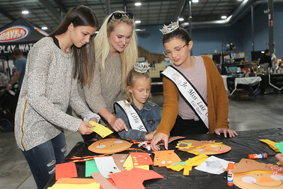 Candace H. Johnson-For Shaw Media Adrianna Demos, 14, of Lake Villa, Brittani Schisler, of Wauconda, and Lily Troyan, 13, Junior Miss Lake County Fair Queen 2018 help Jenna Marasco, 8, Little Miss Lake County Fair Queen 2018, both of Lake Villa, with making a fall craft during the Farm Heritage & Harvest Festival at the Lake County Fairgrounds in Grayslake. (9/22/18)
