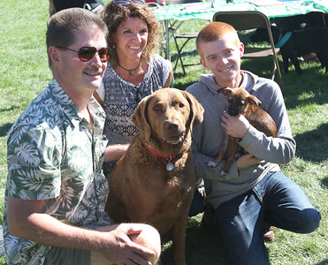 Candace H. Johnson-For Shaw Media Kurt and Mary Kay Kolseth, of Hawthorn Woods, and Mary's son, Jeff Swanlund, 23, get a photo taken with their dog, Chobee, a Chesapeake Bay Retriever, and their newly adopted puppy during Petpalooza at the Lehmann Mansion in Lake Villa. The Chihuahua-mix puppy was adopted from K9s4U Dog Rescue during the event.(9/23/18)