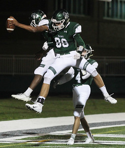 Candace H. Johnson-For Shaw Media Grayslake Central's Nick Paul celebrates his touchdown with Grant Spicer and Jackson Wallis against Round Lake in the second quarter at Grayslake Central High School. Grayslake Central won 41-6.(9/21/18)