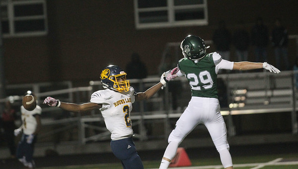 Candace H. Johnson-For Shaw Media Round Lake's Kevonne Peterson leaps up to catch a pass against Grayslake Central's Keaton Dietsch in the fourth quarter at Grayslake Central. Grayslake Central won 41-6.(9/21/18)