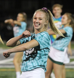 "Candace H. Johnson-For Shaw Media Grayslake Central's Alexandra Young dances to a ""Dancing with the Decades"" theme with her teammates on the Dance Team at half-time during the varsity football game against Round Lake at Grayslake Central. (9/21/18)"