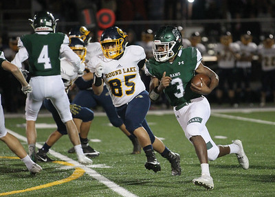 Candace H. Johnson-For Shaw Media Grayslake Central's Nick Paul (#3) runs the ball against Round Lake's Juan Ocampo in the third quarter at Grayslake Central. Grayslake Central won 41-6.(9/21/18)