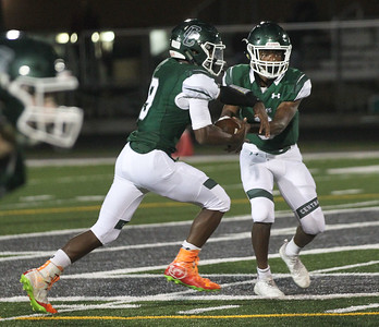 Candace H. Johnson-For Shaw Media Grayslake Central's quarterback Nick Paul (on right) hands off the ball to Maurice Edwards against Round Lake in the first quarter at Grayslake Central High School. Grayslake Central won 41-6.(9/21/18)