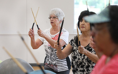 Candace H. Johnson-For Shaw Media Donna Jakstas stands next to Deanna Adduci, both of Fox Lake as they beat their drums using drumsticks and exercise balls during Senior Cardio Drumming at Lakefront Park in Fox Lake. The class is held every Friday from 10:30-11:30 a.m. at Lakefront Park.(9/21/18)