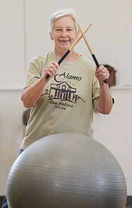 Candace H. Johnson-For Shaw Media Nancy Zachar, of Fox Lake beats her drum (an exercise ball) to 1950's music during Senior Cardio Drumming at Lakefront Park in Fox Lake. The class is held every Friday from 10:30-11:30 a.m. at Lakefront Park.(9/21/18)