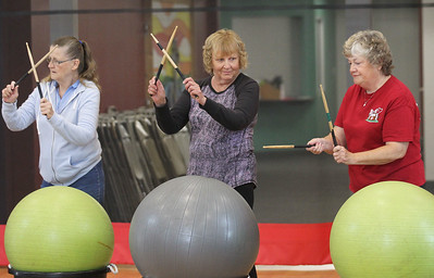 Candace H. Johnson-For Shaw Media Linda Turner, Joyce Picket, both of Fox Lake and Cathy Smith, of Ingleside beat their drums using drumsticks and exercise balls during Senior Cardio Drumming at Lakefront Park in Fox Lake. The class is held every Friday from 10:30-11:30 a.m. at Lakefront Park.(9/21/18)