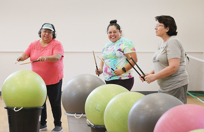 Candace H. Johnson-For Shaw Media Juanita and Sara Aldana, both of Round Lake stand close to Cindy Bogda, of Fox Lake as they beat their drums (exercise balls) during Senior Cardio Drumming at Lakefront Park in Fox Lake. The class is held every Friday from 10:30-11:30 a.m. at Lakefront Park.(9/21/18)