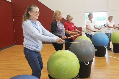 Candace H. Johnson-For Shaw Media Linda Turner, Joyce Picket, both of Fox Lake and Cathy Smith, of Ingleside beat their drums (exercise balls) during Senior Cardio Drumming at Lakefront Park in Fox Lake. The class is held every Friday from 10:30-11:30 a.m. at Lakefront Park.(9/21/18)