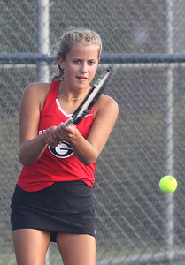 Candace H. Johnson-For Shaw Media Grant's Audrey Sampson, 15, of Round Lake returns the ball against Warren during a doubles match at Grant Community High School in Fox Lake. (9/3/19)