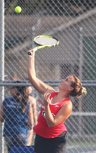 Candace H. Johnson-For Shaw Media Grant's Elis Lelchuk, 17, of Round Lake serves against Warren in doubles match at Grant Community High School in Fox Lake.  (9/3/19)