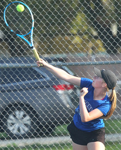 Candace H. Johnson-For Shaw Media Warren's Isabel Grimes, 15, serves against Grant in a singles match at Grant Community High School in Fox Lake. Warren won their overrall game against Grant 6-1. (9/3/19)