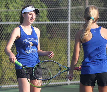 Candace H. Johnson-For Shaw Media Warren's Elizabeth Payson, 15, celebrates a point against Grant with her doubles partner, Kaija Johnson, 14, at Grant Community High School in Fox Lake. Warren won 6-1 in their overrall game against Grant. (9/3/19)