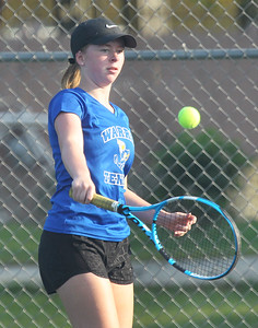 Candace H. Johnson-For Shaw Media Warren's Isabel Grimes, 15, returns the ball against Grant in a singles match at Grant Community High School in Fox Lake. Warren's team won overrall 6-1. (9/3/19)