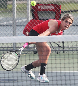 Candace H. Johnson-For Shaw Media Grant's Gianna Vavalle, 15, of Lakemoor returns the ball against Warren in a singles match at Grant Community High School in Fox Lake.  (9/3/19)