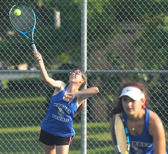 Candace H. Johnson-For Shaw Media Warren's Rachel Shugarts, 17, serves against Grant as she stands next to her doubles partner, Meg Rubino, 16, at Grant Community High School in Fox Lake. Warren won the overrall game 6-1. (9/3/19)