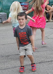 Candace H. Johnson-For Shaw Media Grayson Zwolfer, 4, of Wauconda shows off his dance moves to music by the jam band, Better With Bacon, during the Wauconda Street Dance on Main Street in Wauconda. (8/31/19)