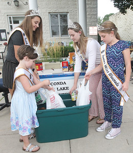 Candace H. Johnson-For Shaw Media Little Miss Volo Arabella Porter, 6, Teen Miss Wauconda Cara Frank, 13, Miss Lakemoor Lily Downing, 17, and Jr. Miss Wauconda Bridget Niziolek, 10, help put bags of donated food collected for the Wauconda/Island Lake Food Pantry into a bin during the Wauconda Street Dance on Main Street in Wauconda. A Community Food Drive sponsored by the Wauconda Area Chamber of Commerce took place during the Street Dance. (8/31/19)