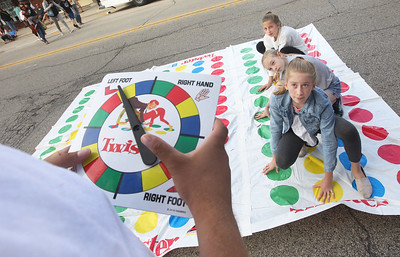 Candace H. Johnson-For Shaw Media D'Quan Mace, 16, of Wauconda calls out the colors as Alexa Albanese, 11, of Crystal Lake and her sister, Jenna, 12, play Twister with Natalie Haughey, 11, of McHenry (center) during the Wauconda Street Dance on Main Street in Wauconda. (8/31/19)