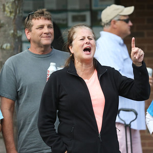 Candace H. Johnson-For Shaw Media Phillip Armie, of Warsaw, Ind., stands behind Beth Hendricks, of Twin Lakes, Wis., as she sings a song by the band, Talking Heads, performed by the Classic Drive band during the Wauconda Street Dance on Main Street in Wauconda. (8/31/19)