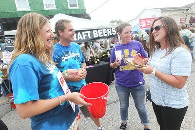 Candace H. Johnson-For Shaw Media Stacy Mergenthaler and Mat Chambers sell some 50/50  raffle tickets and talk with Brooke Barker and Martha Augustine, all of Wauconda during the Wauconda Street Dance on Main Street in Wauconda.Proceeds from the 50/50 raffle tickets went to the Wauconda/Island Lake Food Pantry. (8/31/19)