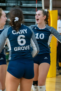 Lauren Passaglia celebrates with her teammates after a tough point against Jacobs.