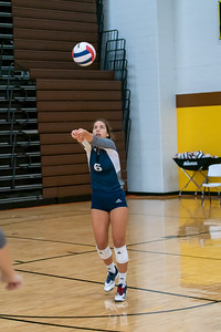 Cary Grove's Evynn Lashock bumps back a serve in the semi final game against Jacobs.