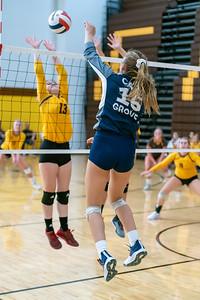 Cary Grove's lefty striker, Jenna Splitt slams a spike over the net.