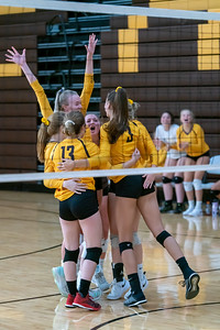The Eagles celebrate a point against the Trojans in the semi final game.