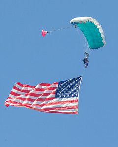 Skydiver Dennis Jenson flies in the American flag to start the 2019 Northern Illinois Airshow held Saturday, September 7, 2019 at the Waukegan National Airport in Waukegan.