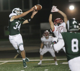 Candace H. Johnson-For Shaw Media Grayslake Central's Ethan Richardson tries to make the catch against Mundelein's Rudy Orsornio in the third quarter at Grayslake Central High School. Mundelein won 31-13. (9/6/19)
