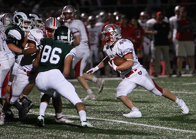 Candace H. Johnson-For Shaw Media Mundelein's Joey Foreman (#40) looks to get past Grayslake Central's defender Ryan Atkinson in the fourth quarter at Grayslake Central High School. Mundelein won 31-13. (9/6/19)