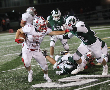Candace H. Johnson-For Shaw Media Mundelein's Patrick Shawn stops the tackle by Grayslake Central's Joey Jens in the third quarter at Grayslake Central High School. Mundelein won 31-13. (9/6/19)