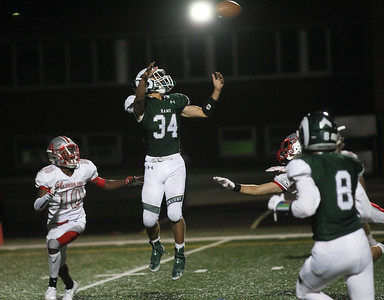Candace H. Johnson-For Shaw Media Grayslake Central's Ethan Richardson leaps up for the catch against Mundelein's Deangelo McClellan in the third quarter at Grayslake Central High School. Mundelein won 31-13. (9/6/19)