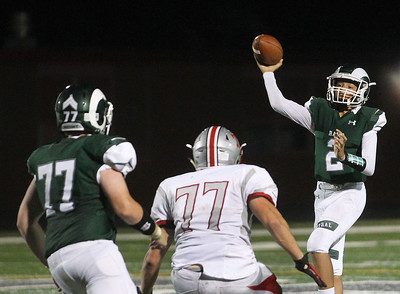 Candace H. Johnson-For Shaw Media Grayslake Central's quarterback, Darryl Overstreet, (#2) looks to pass against Mundelein's Dennis Jaxon (#77) in the third quarter at Grayslake Central High School. Mundelein won 31-13. (9/6/19)