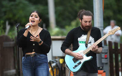 Candace H. Johnson-For Shaw Media Jazmin Cardoza, of Waukegan and Zach Barraza, of Round Lake with a band called, Green Noise, perform a Rolling Stones song during the Fox Lake Summer Art Series Friday Night Concerts at the Community Garden Green on School Ct. in Fox Lake. The next concerts are on September 13th and September 27th from 6:30-7:30 pm. (9/6/19)
