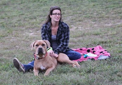 Candace H. Johnson-For Shaw Media Diane Taschetta, of Spring Grove sits with her dog, Rufus, as she listens to a blues/rock band called, Green Noise, during the Fox Lake Summer Art Series Friday Night Concerts at the Community Garden Green on School Ct. in Fox Lake. The next concerts are on September 13th and September 27th from 6:30-7:30 pm. (9/6/19)