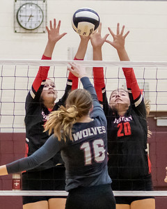 Huntley's Allyson Panzloff (left) and Ashley Konecki (right) block a shot from Prairie Ridge's Hayle Yelle Tuesday, September 17, 2019 in Crystal Lake. Huntley went on to win in two straight sets.