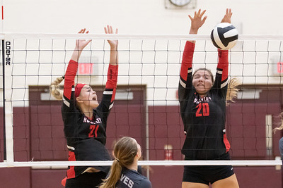 Huntley's Ashley Konecki (right) gets a block against Prairie Ridge Tuesday, September 17, 2019 in Crystal Lake. Huntley went on to win in two straight sets.