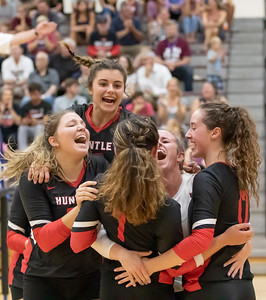 The Huntley High School volleyball team celebrates the two-set win over Prairie Ridge Tuesday, September 17, 2019 in Crystal Lake.