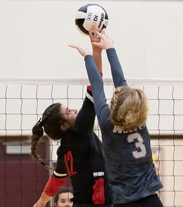 Huntley's Taylor Jakubowski (left) and Prairie Ridge's Hannah Baudin (right) battle it out at the net Tuesday, September 17, 2019 in Crystal Lake. Huntley went on to win in two straight sets.