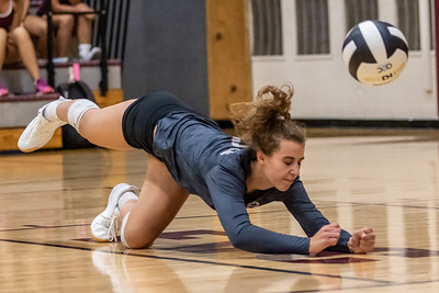 Prairie Ridge's Ansley Morlock dives for the ball against Huntley Tuesday, September 17, 2019 in Crystal Lake. Huntley went on to win in two straight sets.
