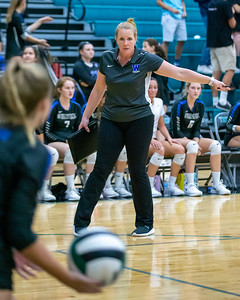 Woodstock head volleyball coach Jill Rokosik directs her player against Woodstock North Wednesday, September 18, 2019 at Woodstock North High School. Woodstock gets the win in two sets.