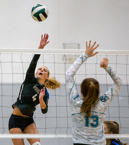 Woodstock's Hanna Berry (left) drives the ball over the net against Woodstock North Wednesday, September 18, 2019 at Woodstock North High School. Woodstock gets the win in two sets.