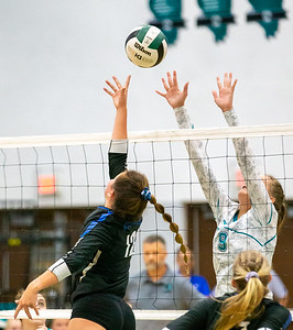 Woodstock's Sophia Wicker (left) and Woodstock North's Cadence Klasek (right) battle it out at the net Wednesday, September 18, 2019 at Woodstock North High School. Woodstock gets the win in two sets.